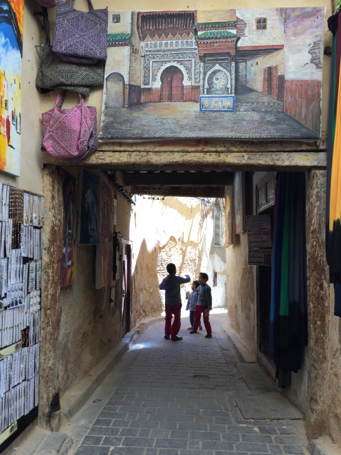 Kids playing ball in the narrow streets of Fez
