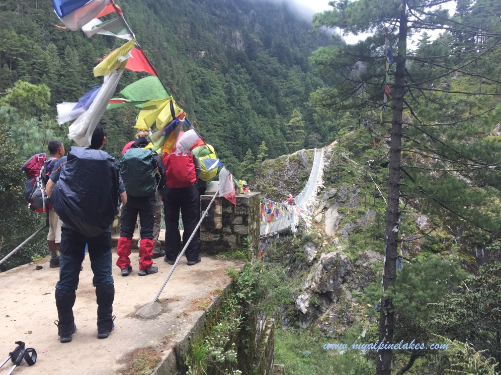 People lined up at a bridge to cross the canyon