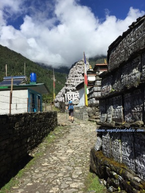 Walking by walls of prayer tablets