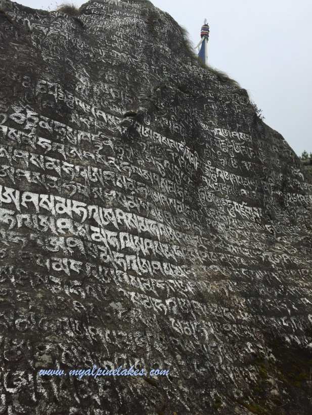 large rock wall of scriptures