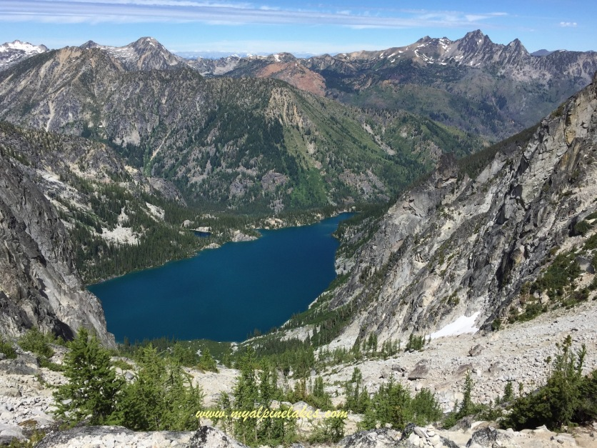 Looking back at Colchuck Lake and the mountain ranges in the distance