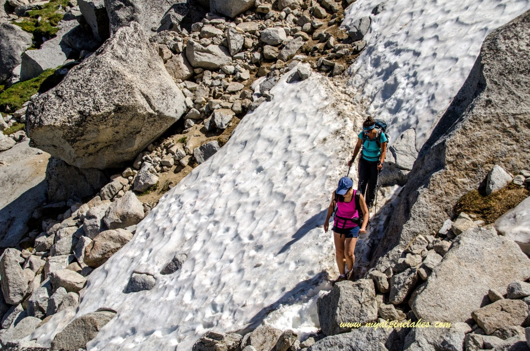 Gingerly crossing a slippery snowfield on a steep terrain
