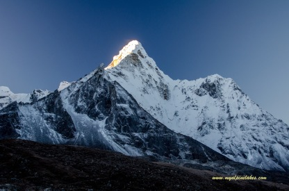 Dawn breaking to light up the east face of Ama Dablam