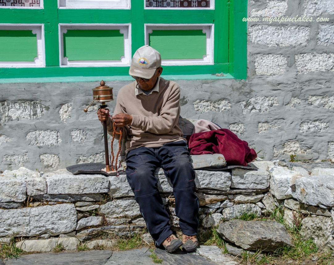 The father of our tea house host and his prayer wheel and chitta mala (rosary).