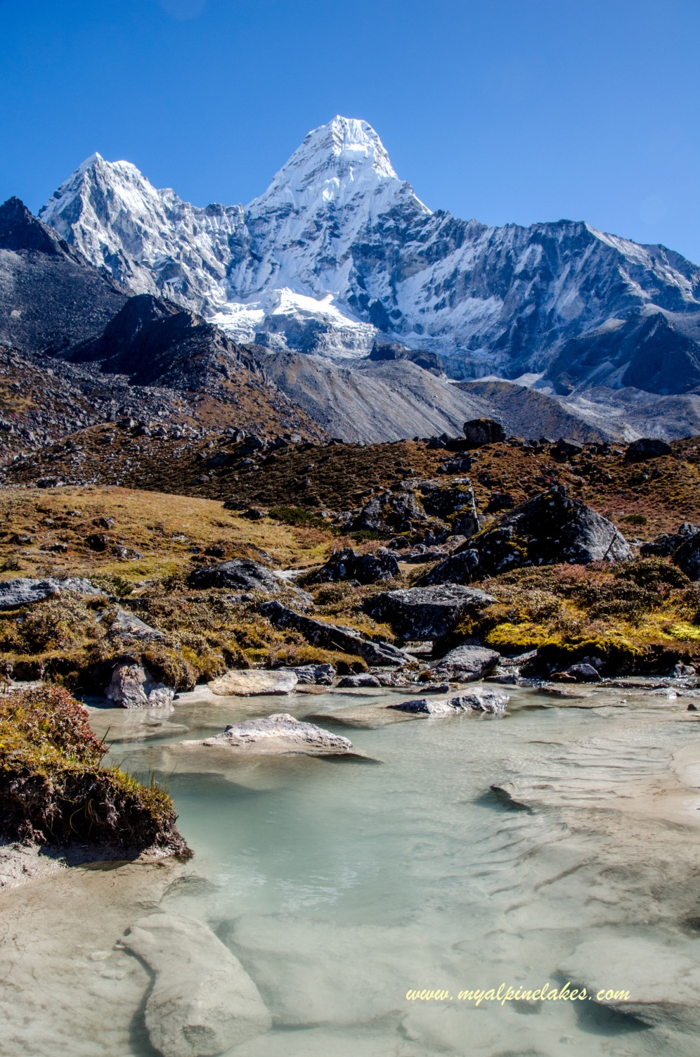 turquoise glacial melt water in front of Ama Dablam