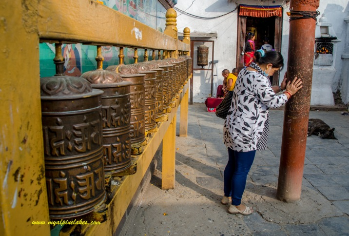Prayer wheels lined up the side of Boudhanath
