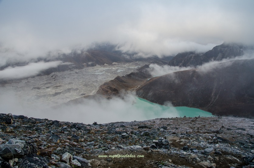 Clouds moved in quickly. Mountains that were visible in moonlight are no longer visible at this point. You can still see a sliver of Gokyo Lake.