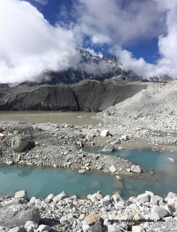 More tarns dotting the scree field left by receding Ngozumpa Glacier