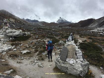Walking by a pile of prayer rocks