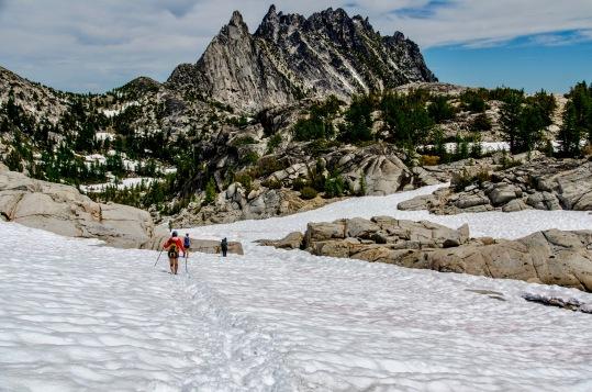 Trudging towards those jagged Prusik Peaks