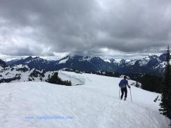 carefully trudge towards the east peak