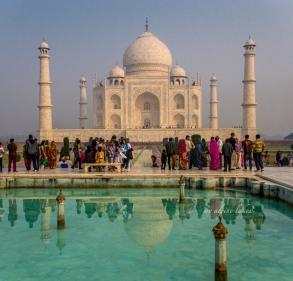 Taj Mahal reflected in a pool.. with a crowd