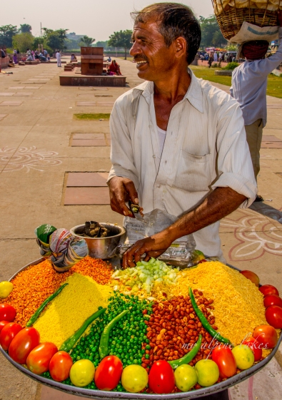 I LOVE the color the food this man is selling.