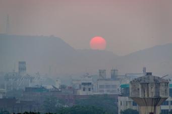 Sunrise over a mountain range in Jaipur