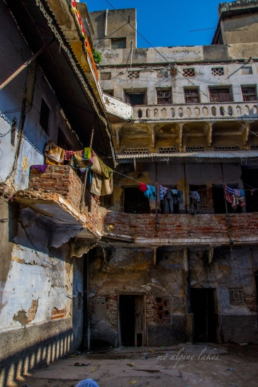 People find home in a half destroyed courtyard a short distance from the shrine