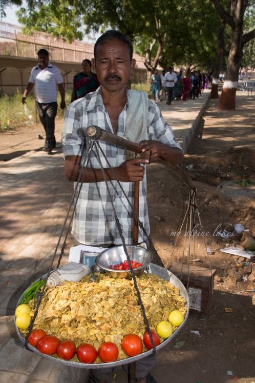 Street vendor carrying colorful food around the city.