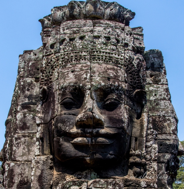 One of many enormous face carvings in the temples of Siem Reap.