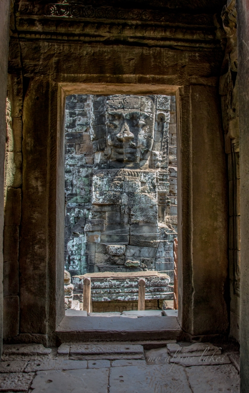 An intricately carved face on a tower in a temple in Siem Reap.