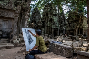 An artist's rendition of fallen walls and overgrown vegetation in Angkor Wat
