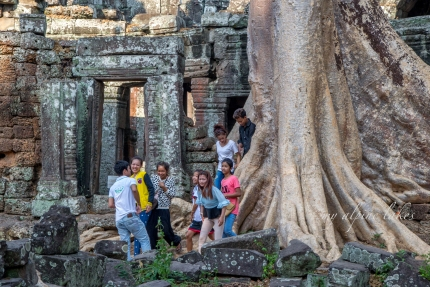 Teenagers being rowdy in Ta Prohm temple