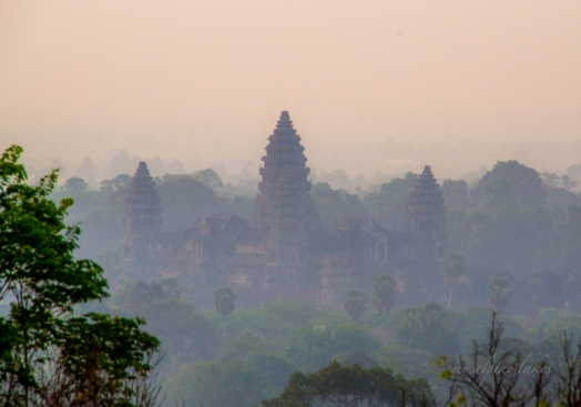 Looking down at Angkor Wat from Bakheng temple at sunrise
