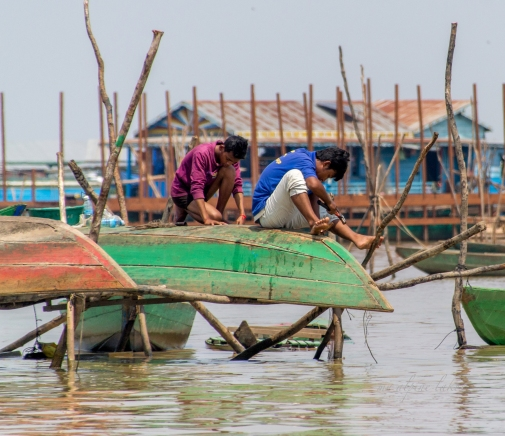 Men fixing up their boats.