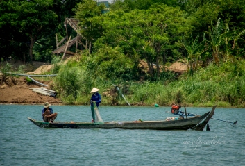On Mekong river near Chau Doc where fisherman meticulously sorting out their net for a cast.