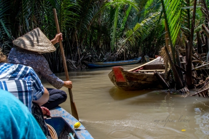 A boat tour through the narrow channels of Mekong Delta.