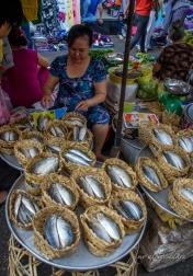 Fish in a basket in an open market.