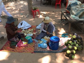 Women selling fruit to foreign tourists like me. They are pretty successful in this hot and humid weather. It's only the spring. What is summer like here?