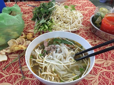 My first bowl of Pho in Vietnam. it was at a bus stop. $2 for this baby. I think it may be full of MSG but it tasted great.