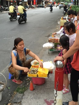 Leopard print onesie woman making quail egg omelette on the street. It was delicious.