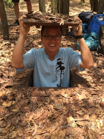 Cu Chi Tunnels near Ho Chi Minh. Don't be deceived by that smile. I fully regret going down that tunnel. It was dark and damn and had only enough space to crawl through on all four. I had no idea what I was crawling on: rotten leaves? worms? No idea. The worst of all, there are bats flying around you in that tiny space. I am glad I didn't catch rabies.