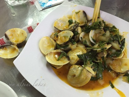 A plate of stir fried manilla clams.