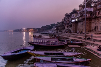 nightfall on the ghats of Varanasi. The boats sway by the gentle waves of Ganges.