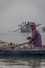 A boat vendor of small souvenirs on Ganges.