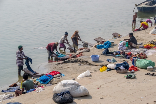 People washing their clothes in the Ganges. Not sure if it's dirtier before or after the washing.
