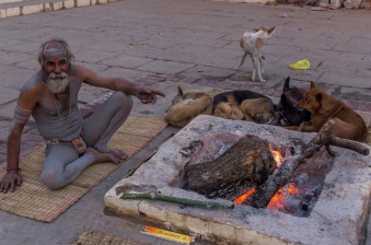 A Sadhu made a fire to keep he and his friends warm in the early morning.
