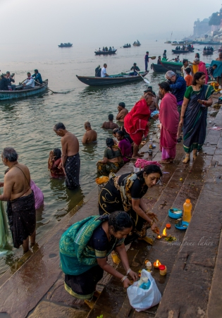Praying to the gods on the Ganges river bank.