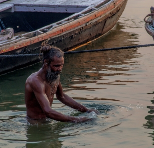 A sadhu went in the river for a morning dip.