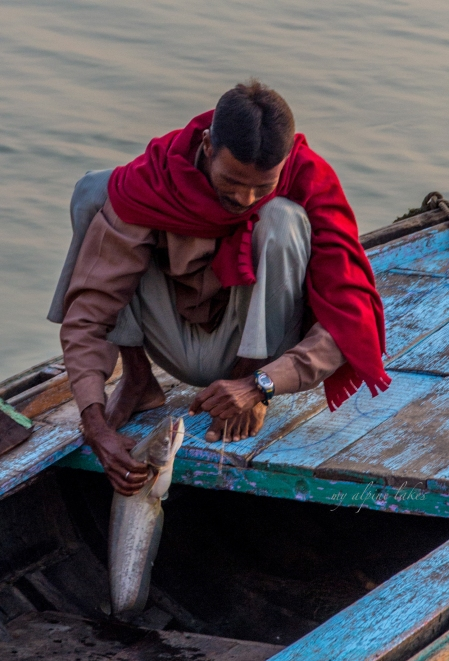 A man happy with his catch of the day from the river.