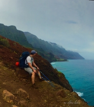 Taking a breather on top of a cliff.