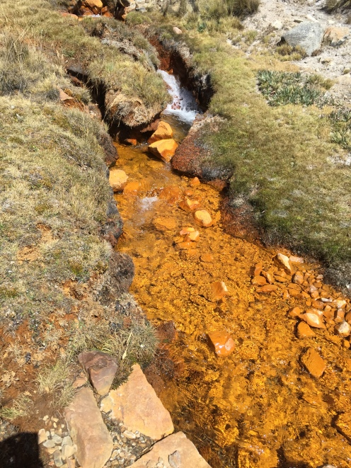 You DO NOT want to drink this water with orange sediments.