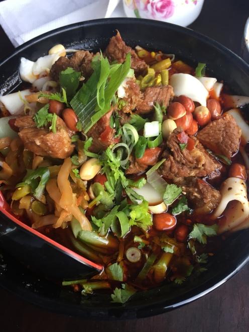 wide hand cut noodles in beef stew